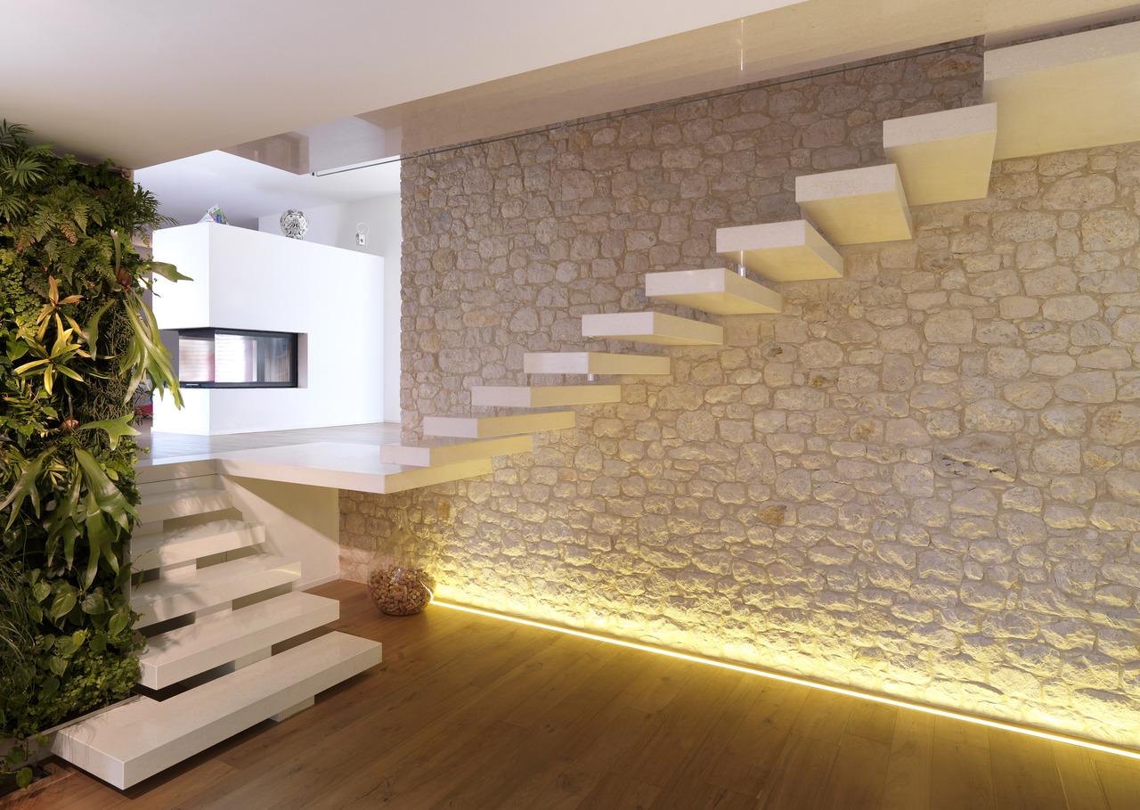 Grassi pietre per la ristrutturazione di una villa privata for Abitazioni interni